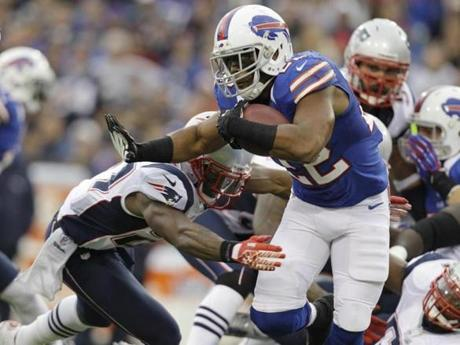 The Bills' Fred Jackson ran against the Patriots during the first half .